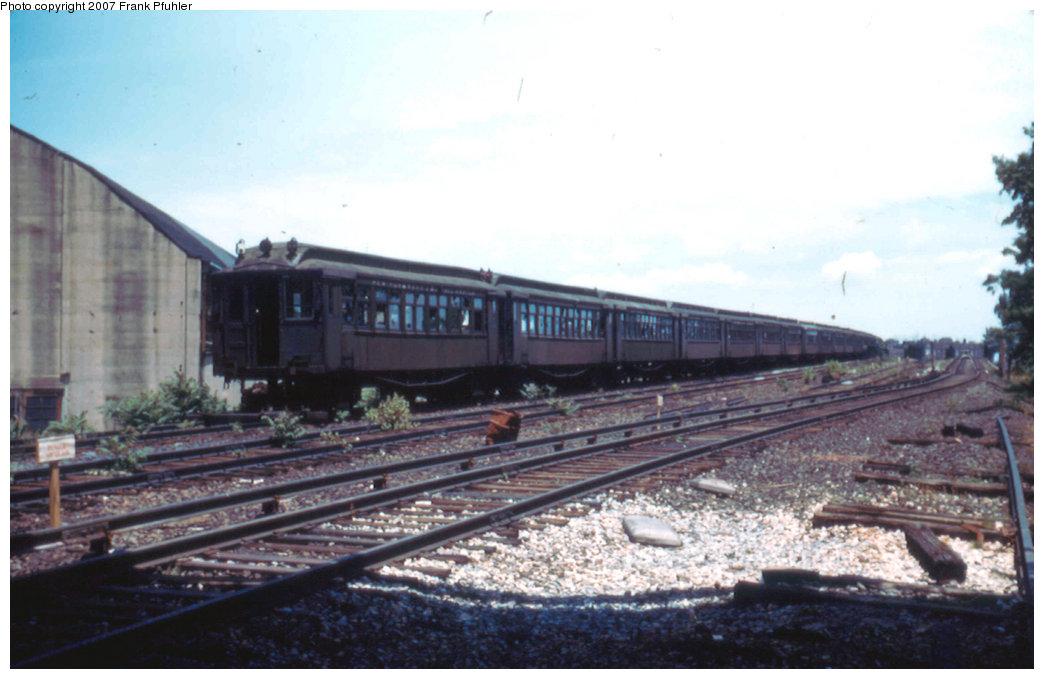 (172k, 1044x679)<br><b>Country:</b> United States<br><b>City:</b> New York<br><b>System:</b> New York City Transit<br><b>Location:</b> NYW&B right of way nr. E 174th St./Cross Bronx Expy. at jct. with New Haven RR<br><b>Car:</b> MUDC  <br><b>Photo by:</b> Frank Pfuhler<br><b>Date:</b> 6/4/1955<br><b>Notes:</b> Scrapping.<br><b>Viewed (this week/total):</b> 0 / 2512