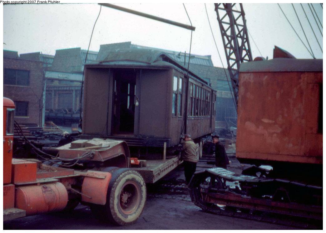 (176k, 1044x747)<br><b>Country:</b> United States<br><b>City:</b> New York<br><b>System:</b> New York City Transit<br><b>Location:</b> Coney Island Yard<br><b>Route:</b> Being removed for scrapping.<br><b>Car:</b> BMT Q  <br><b>Photo by:</b> Frank Pfuhler<br><b>Date:</b> 3/5/1955<br><b>Viewed (this week/total):</b> 0 / 1347