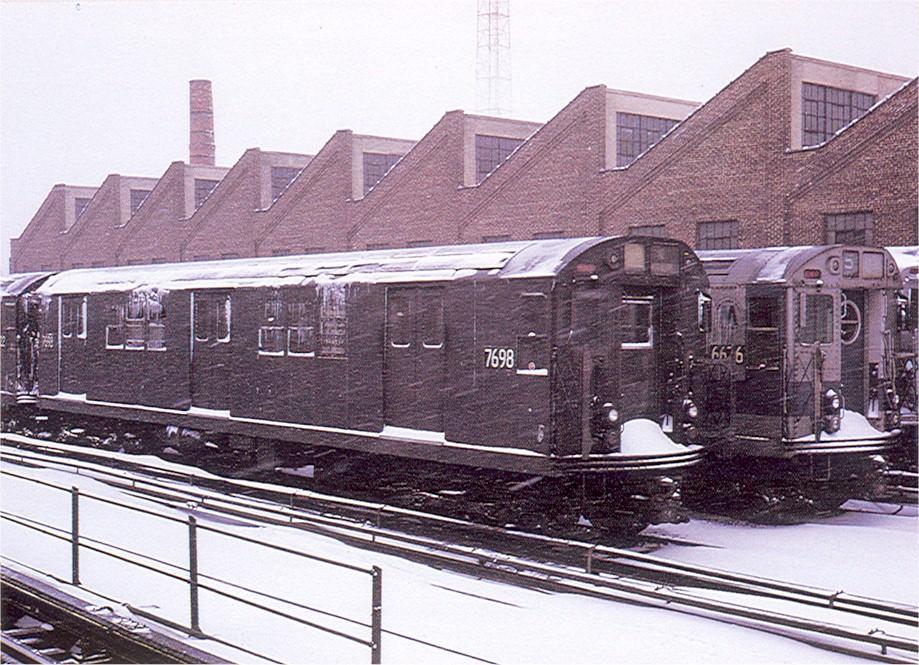 (233k, 919x665)<br><b>Country:</b> United States<br><b>City:</b> New York<br><b>System:</b> New York City Transit<br><b>Location:</b> East 180th Street Yard<br><b>Car:</b> R-22 (St. Louis, 1957-58) 7698 <br><b>Collection of:</b> Joe Testagrose<br><b>Date:</b> 1971<br><b>Viewed (this week/total):</b> 5 / 1777