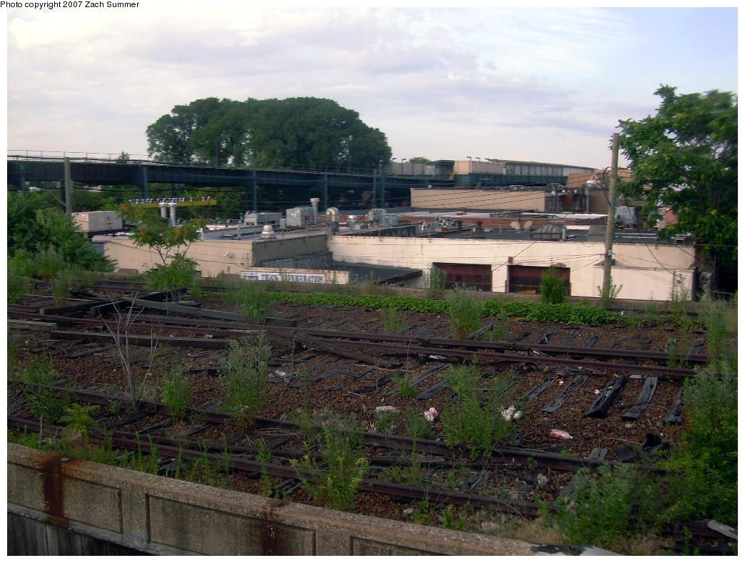 (307k, 1044x788)<br><b>Country:</b> United States<br><b>City:</b> New York<br><b>System:</b> Long Island Rail Road<br><b>Line:</b> LIRR Rockaway<br><b>Location:</b> Ozone Park <br><b>Photo by:</b> Zach Summer<br><b>Date:</b> 7/22/2007<br><b>Notes:</b> Remains of LIRR Rockaway branch north of the IND connection, south of former Ozone Park station.<br><b>Viewed (this week/total):</b> 0 / 1745