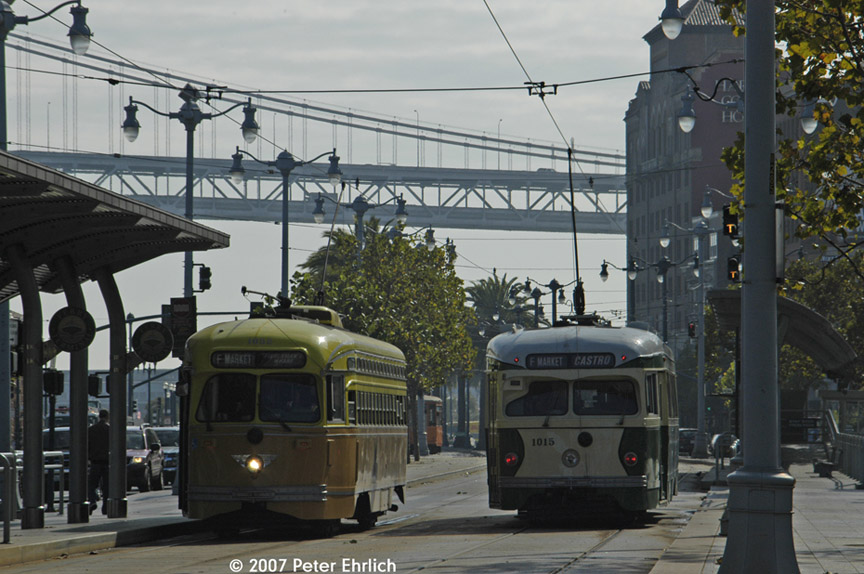 (188k, 864x574)<br><b>Country:</b> United States<br><b>City:</b> San Francisco/Bay Area, CA<br><b>System:</b> SF MUNI<br><b>Location:</b> Embarcadero/Ferry Building <br><b>Car:</b> SF MUNI PCC (Ex-SEPTA) (St. Louis Car Co., 1947-1948)  1052 <br><b>Photo by:</b> Peter Ehrlich<br><b>Date:</b> 11/9/2007<br><b>Notes:</b> Ferry Building stop inbound.  With 1015 (Illinois Terminal) outbound.<br><b>Viewed (this week/total):</b> 1 / 411