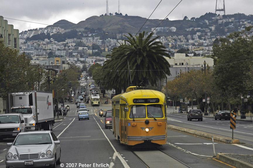 (200k, 864x574)<br><b>Country:</b> United States<br><b>City:</b> San Francisco/Bay Area, CA<br><b>System:</b> SF MUNI<br><b>Location:</b> Market/Dolores<br><b>Car:</b> SF MUNI PCC (Ex-SEPTA) (St. Louis Car Co., 1947-1948) 1052 <br><b>Photo by:</b> Peter Ehrlich<br><b>Date:</b> 10/30/2007<br><b>Notes:</b> Approaching Market/Dolores inbound.  With 1015 (Illinois Terminal) at Market/Church inbound in background.<br><b>Viewed (this week/total):</b> 1 / 793