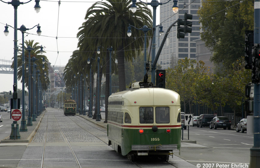 (185k, 864x558)<br><b>Country:</b> United States<br><b>City:</b> San Francisco/Bay Area, CA<br><b>System:</b> SF MUNI<br><b>Location:</b> Embarcadero/Broadway <br><b>Car:</b> SF MUNI PCC (Ex-SEPTA) (St. Louis Car Co., 1947-1948)  1055 <br><b>Photo by:</b> Peter Ehrlich<br><b>Date:</b> 11/25/2007<br><b>Notes:</b> Embarcadero/Broadway outbound, trailing view.  With 496 (Melbourne) ahead, outbound.<br><b>Viewed (this week/total):</b> 0 / 577