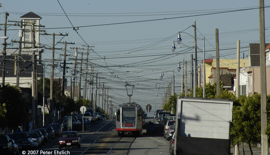 (167k, 864x497)<br><b>Country:</b> United States<br><b>City:</b> San Francisco/Bay Area, CA<br><b>System:</b> SF MUNI<br><b>Line:</b> MUNI Metro (K/M)<br><b>Location:</b> Broad/Plymouth<br><b>Car:</b> SF MUNI Breda LRV 1424 <br><b>Photo by:</b> Peter Ehrlich<br><b>Date:</b> 11/22/2007<br><b>Notes:</b> Broad/Plymouth inbound, trailing view.  Looking west from San Jose Avenue.<br><b>Viewed (this week/total):</b> 1 / 700