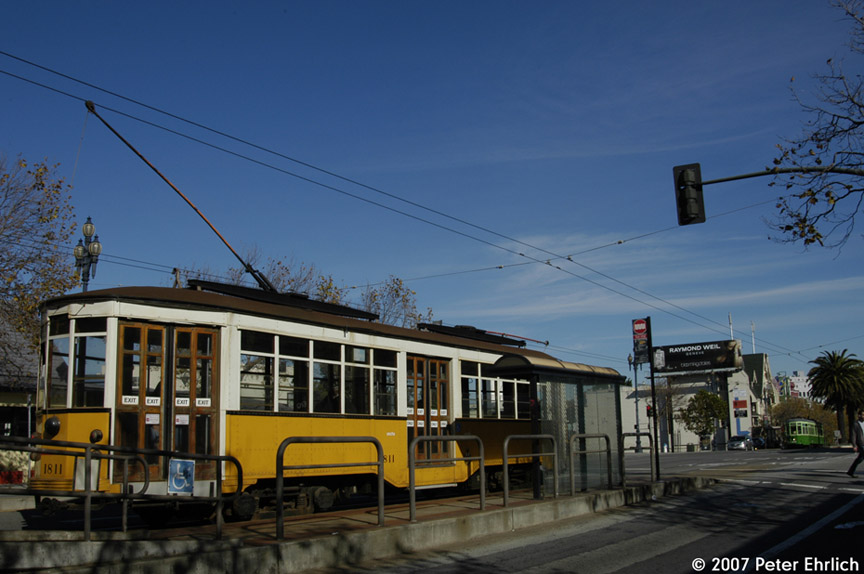 (160k, 864x574)<br><b>Country:</b> United States<br><b>City:</b> San Francisco/Bay Area, CA<br><b>System:</b> SF MUNI<br><b>Location:</b> Market/15th/Sanchez <br><b>Car:</b> Milan Milano/Peter Witt (1927-1930)  1811 <br><b>Photo by:</b> Peter Ehrlich<br><b>Date:</b> 11/14/2007<br><b>Notes:</b> Market/Sanchez/15th Street inbound.  With 1818 (Milan 1929 2-tone green) outbound.<br><b>Viewed (this week/total):</b> 0 / 462