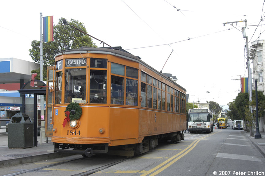 (167k, 864x574)<br><b>Country:</b> United States<br><b>City:</b> San Francisco/Bay Area, CA<br><b>System:</b> SF MUNI<br><b>Location:</b> Market/17th/Castro<br><b>Car:</b> Milan Milano/Peter Witt (1927-1930) 1814 <br><b>Photo by:</b> Peter Ehrlich<br><b>Date:</b> 11/24/2007<br><b>Notes:</b> 17th/Castro Terminal.  With Neoplan bus 8181 behind, in F-Line service.  PCC 1052 (Los Angeles) is on the straight track in the background.<br><b>Viewed (this week/total):</b> 1 / 599
