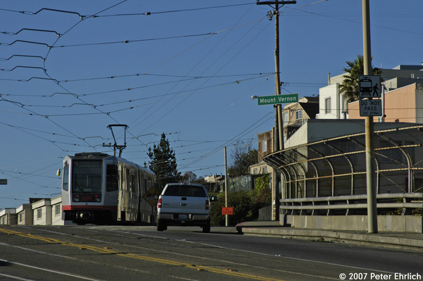 (167k, 864x574)<br><b>Country:</b> United States<br><b>City:</b> San Francisco/Bay Area, CA<br><b>System:</b> SF MUNI<br><b>Line:</b> MUNI Metro (K/M)<br><b>Location:</b> San Jose/Mt. Vernon<br><b>Car:</b> SF MUNI Breda LRV 1518 <br><b>Photo by:</b> Peter Ehrlich<br><b>Date:</b> 11/22/2007<br><b>Notes:</b> San Jose/Mt. Vernon inbound, trailing view.<br><b>Viewed (this week/total):</b> 3 / 732