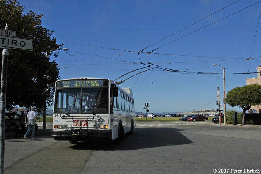 (156k, 864x574)<br><b>Country:</b> United States<br><b>City:</b> San Francisco/Bay Area, CA<br><b>System:</b> SF MUNI<br><b>Line:</b> SF MUNI Trolley Coach Routes<br><b>Car:</b> SF MUNI Trolley Coach (ETI 14Tr-SF 40ft., 2001-03) 5413 <br><b>Photo by:</b> Peter Ehrlich<br><b>Date:</b> 9/3/2007<br><b>Notes:</b> Looping at Marina Green (Fillmore/Marina Blvd), line 22-Fillmore.  Alcatraz is in the background.<br><b>Viewed (this week/total):</b> 0 / 794