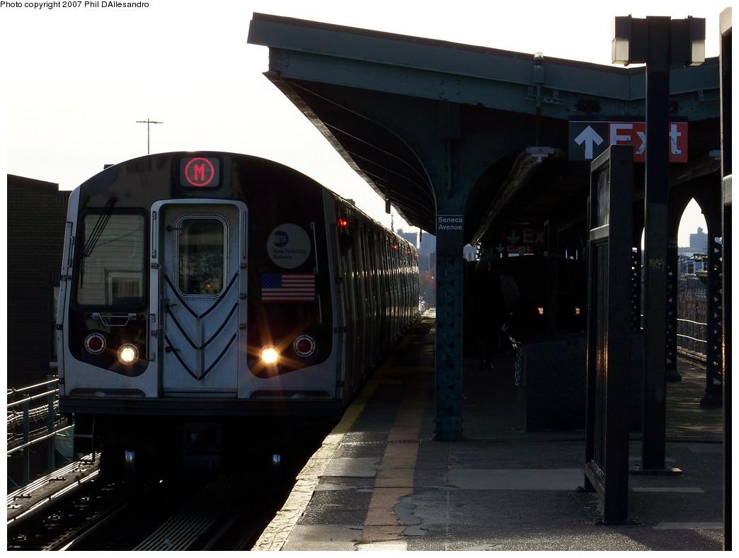 (174k, 1044x788)<br><b>Country:</b> United States<br><b>City:</b> New York<br><b>System:</b> New York City Transit<br><b>Line:</b> BMT Myrtle Avenue Line<br><b>Location:</b> Seneca Avenue <br><b>Route:</b> M<br><b>Car:</b> R-143 (Kawasaki, 2001-2002)  <br><b>Photo by:</b> Philip D'Allesandro<br><b>Date:</b> 12/1/2007<br><b>Viewed (this week/total):</b> 4 / 2153