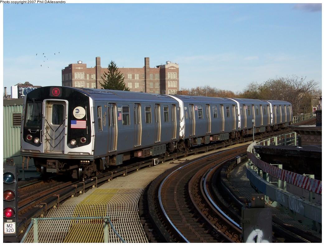 (236k, 1044x788)<br><b>Country:</b> United States<br><b>City:</b> New York<br><b>System:</b> New York City Transit<br><b>Line:</b> BMT Myrtle Avenue Line<br><b>Location:</b> Seneca Avenue <br><b>Route:</b> M<br><b>Car:</b> R-143 (Kawasaki, 2001-2002) 8300 <br><b>Photo by:</b> Philip D'Allesandro<br><b>Date:</b> 12/1/2007<br><b>Viewed (this week/total):</b> 1 / 2401