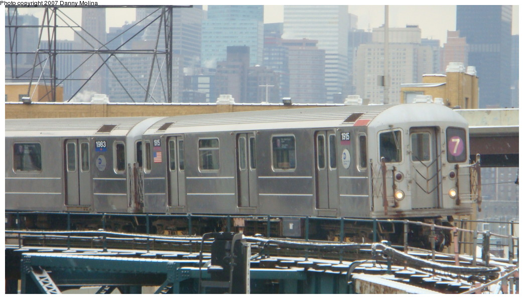 (180k, 1044x596)<br><b>Country:</b> United States<br><b>City:</b> New York<br><b>System:</b> New York City Transit<br><b>Line:</b> IRT Flushing Line<br><b>Location:</b> Queensborough Plaza <br><b>Route:</b> 7<br><b>Car:</b> R-62A (Bombardier, 1984-1987)  1915 <br><b>Photo by:</b> Danny Molina<br><b>Date:</b> 12/3/2007<br><b>Viewed (this week/total):</b> 1 / 1913