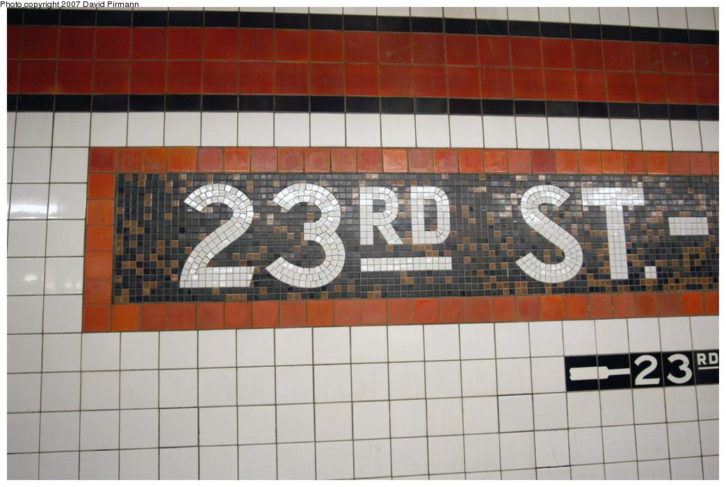 (270k, 1044x701)<br><b>Country:</b> United States<br><b>City:</b> New York<br><b>System:</b> New York City Transit<br><b>Line:</b> IND Queens Boulevard Line<br><b>Location:</b> Court Square/23rd St (Ely Avenue) <br><b>Photo by:</b> David Pirmann<br><b>Date:</b> 12/9/2007<br><b>Notes:</b> Mosaic tile.<br><b>Viewed (this week/total):</b> 3 / 1144