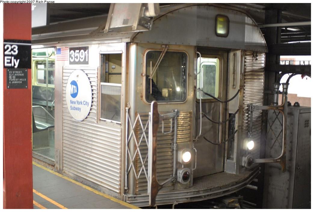 (172k, 1044x706)<br><b>Country:</b> United States<br><b>City:</b> New York<br><b>System:</b> New York City Transit<br><b>Line:</b> IND Queens Boulevard Line<br><b>Location:</b> Court Square/23rd St (Ely Avenue) <br><b>Route:</b> E<br><b>Car:</b> R-32 (Budd, 1964)  3591 <br><b>Photo by:</b> Richard Panse<br><b>Date:</b> 12/9/2007<br><b>Viewed (this week/total):</b> 3 / 2755