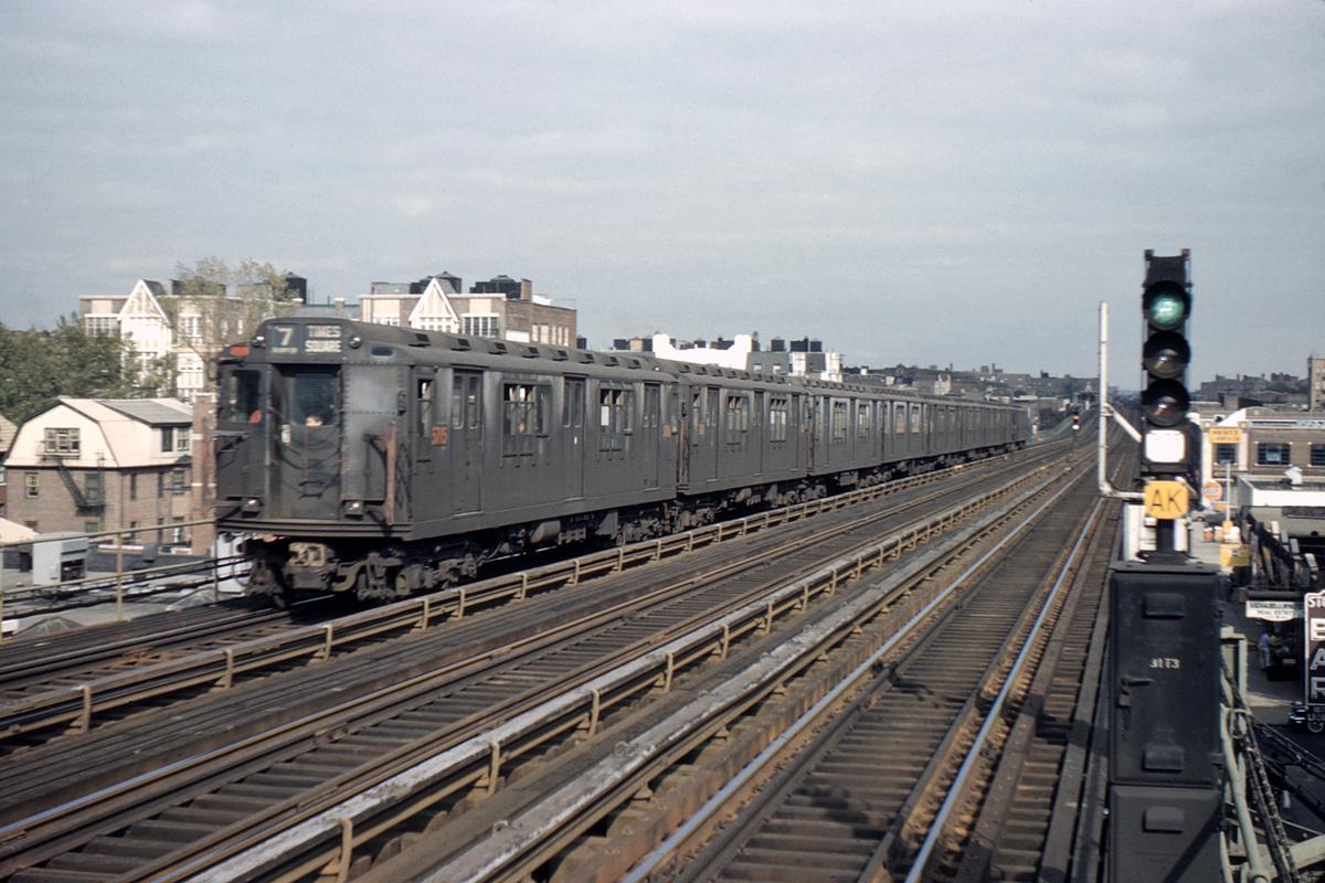 (386k, 1044x706)<br><b>Country:</b> United States<br><b>City:</b> New York<br><b>System:</b> New York City Transit<br><b>Line:</b> IRT Flushing Line<br><b>Location:</b> 74th Street/Broadway <br><b>Car:</b> R-12 (American Car & Foundry, 1948) 5715 <br><b>Photo by:</b> Ed Davis, Sr.<br><b>Collection of:</b> David Pirmann<br><b>Date:</b> 9/1960<br><b>Viewed (this week/total):</b> 1 / 2857