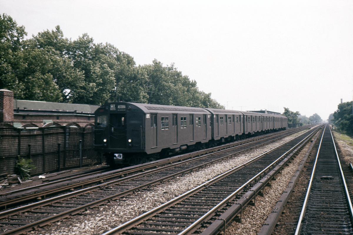 (426k, 1024x682)<br><b>Country:</b> United States<br><b>City:</b> New York<br><b>System:</b> New York City Transit<br><b>Line:</b> BMT Brighton Line<br><b>Location:</b> Avenue J <br><b>Route:</b> QT<br><b>Car:</b> R-30 (St. Louis, 1961) 8295 <br><b>Photo by:</b> Ed Davis, Sr.<br><b>Collection of:</b> David Pirmann<br><b>Date:</b> 7/1961<br><b>Viewed (this week/total):</b> 4 / 3481