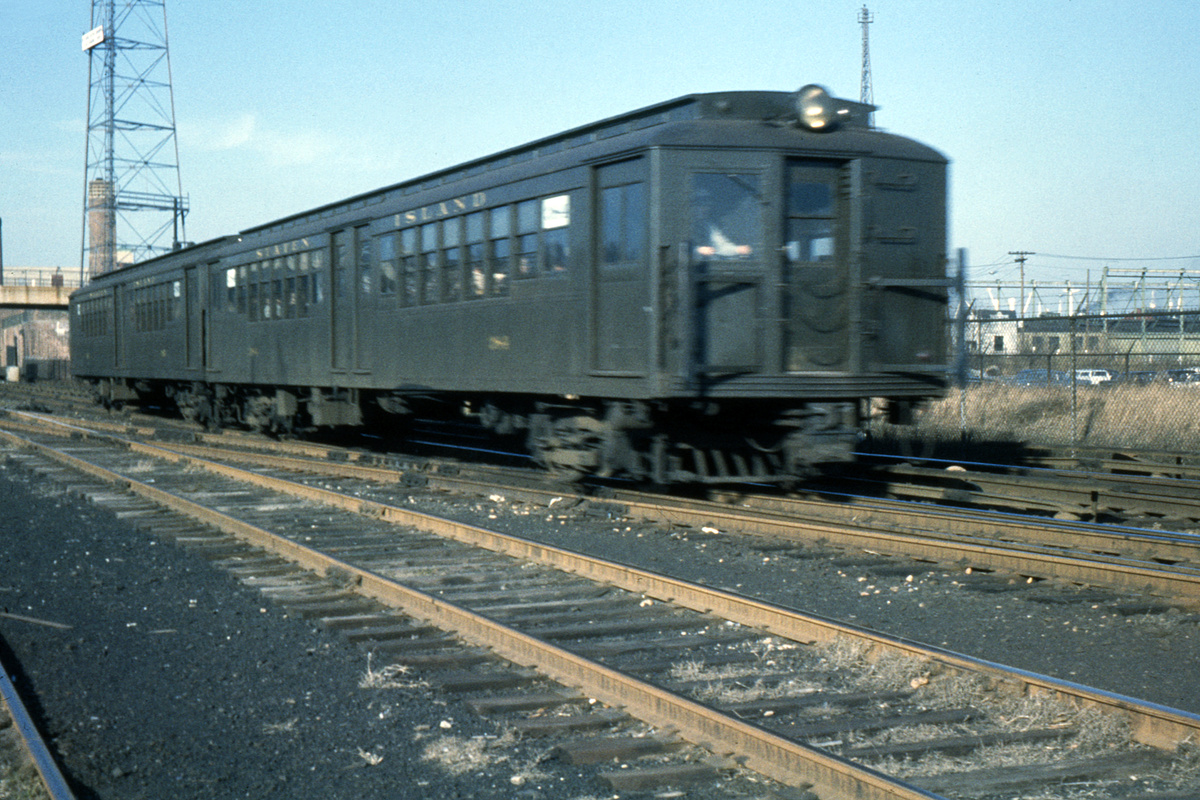 (446k, 1024x683)<br><b>Country:</b> United States<br><b>City:</b> New York<br><b>System:</b> New York City Transit<br><b>Line:</b> SIRT<br><b>Location:</b> Tompkinsville <br><b>Car:</b> SIRT ME-1 (Motor) 384 <br><b>Photo by:</b> Ed Davis, Sr.<br><b>Collection of:</b> David Pirmann<br><b>Date:</b> 11/1961<br><b>Viewed (this week/total):</b> 1 / 2351