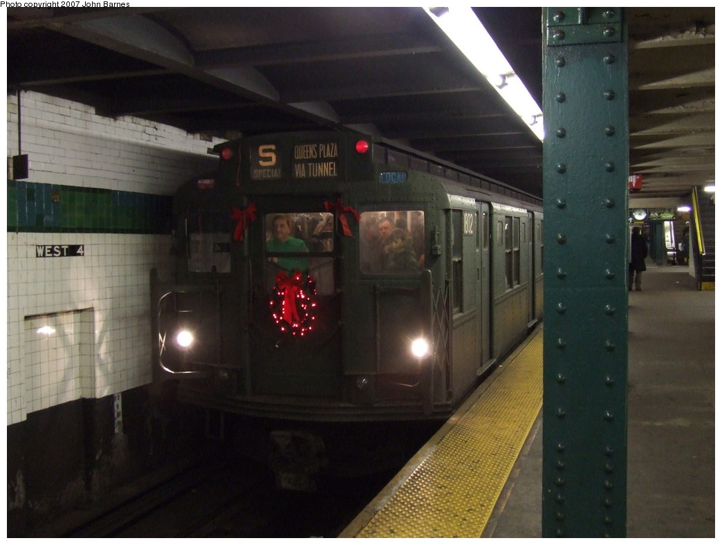 (182k, 1044x788)<br><b>Country:</b> United States<br><b>City:</b> New York<br><b>System:</b> New York City Transit<br><b>Line:</b> IND 6th Avenue Line<br><b>Location:</b> West 4th Street/Washington Square<br><b>Route:</b> Museum Train Service (V)<br><b>Car:</b> R-9 (Pressed Steel, 1940) 1802 <br><b>Photo by:</b> John Barnes<br><b>Date:</b> 12/16/2007<br><b>Notes:</b> Train in regular Nostalgia Train service - not technically a fan trip.<br><b>Viewed (this week/total):</b> 0 / 2396