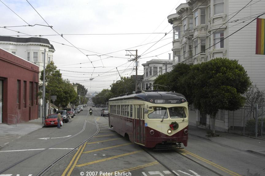 (166k, 864x574)<br><b>Country:</b> United States<br><b>City:</b> San Francisco/Bay Area, CA<br><b>System:</b> SF MUNI<br><b>Location:</b> Market/17th/Castro <br><b>Car:</b> SF MUNI PCC Torpedo Double-End (St. Louis Car Co., 1948)  1007 <br><b>Photo by:</b> Peter Ehrlich<br><b>Date:</b> 12/15/2007<br><b>Notes:</b> 17th Street/Castro Terminal.<br><b>Viewed (this week/total):</b> 0 / 492