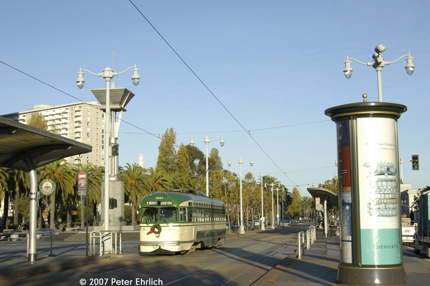 (169k, 864x574)<br><b>Country:</b> United States<br><b>City:</b> San Francisco/Bay Area, CA<br><b>System:</b> SF MUNI<br><b>Location:</b> Embarcadero/Ferry Building <br><b>Car:</b> SF MUNI PCC (Ex-SEPTA) (St. Louis Car Co., 1947-1948)  1051 <br><b>Photo by:</b> Peter Ehrlich<br><b>Date:</b> 11/28/2007<br><b>Notes:</b> Approaching Ferry Building outbound.<br><b>Viewed (this week/total):</b> 0 / 626
