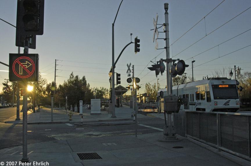 (155k, 864x574)<br><b>Country:</b> United States<br><b>City:</b> San Jose, CA<br><b>System:</b> Santa Clara VTA<br><b>Line:</b> VTA Vasona Line<br><b>Location:</b> San Fernando <br><b>Car:</b> VTA Kinki-Sharyo 974 <br><b>Photo by:</b> Peter Ehrlich<br><b>Date:</b> 12/15/2007<br><b>Notes:</b> Arriving San Fernando Station outbound, trailing view, looking into the sun.<br><b>Viewed (this week/total):</b> 0 / 863