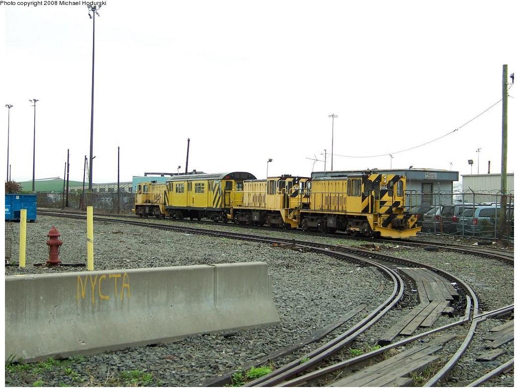 (228k, 1044x790)<br><b>Country:</b> United States<br><b>City:</b> New York<br><b>System:</b> New York City Transit<br><b>Line:</b> South Brooklyn Railway<br><b>Location:</b> SBK Yard (2nd Ave at 38th St.) (SBK)<br><b>Route:</b> Work Service<br><b>Car:</b> R-77 Locomotive  884 <br><b>Photo by:</b> Michael Hodurski<br><b>Date:</b> 1/1/2006<br><b>Viewed (this week/total):</b> 2 / 1909