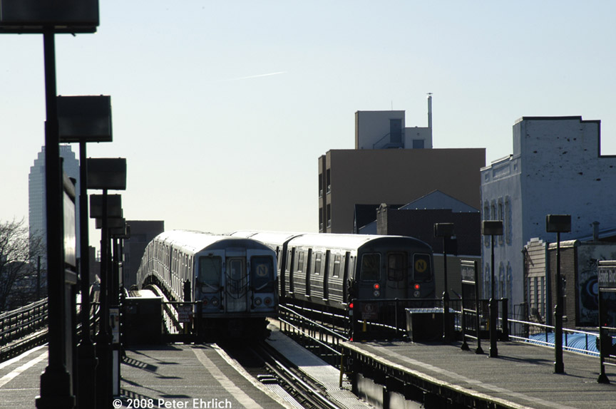 (147k, 864x574)<br><b>Country:</b> United States<br><b>City:</b> New York<br><b>System:</b> New York City Transit<br><b>Line:</b> BMT Astoria Line<br><b>Location:</b> Astoria Boulevard/Hoyt Avenue <br><b>Route:</b> N<br><b>Car:</b> R-68 (Westinghouse-Amrail, 1986-1988)  2840 <br><b>Photo by:</b> Peter Ehrlich<br><b>Date:</b> 1/3/2008<br><b>Notes:</b> Leaving Astoria Blvd. inbound, trailing view.  With 4298 on center track.<br><b>Viewed (this week/total):</b> 3 / 2413