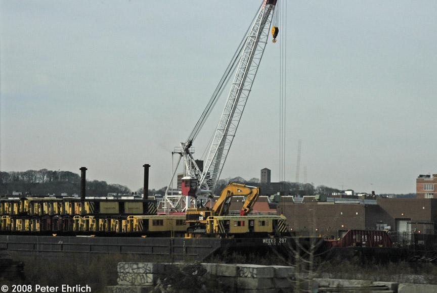 (148k, 864x580)<br><b>Country:</b> United States<br><b>City:</b> New York<br><b>System:</b> New York City Transit<br><b>Location:</b> 207th Street Yard<br><b>Photo by:</b> Peter Ehrlich<br><b>Date:</b> 1/10/2008<br><b>Notes:</b> Old cars on reefing barge at 207th Street Yard.<br><b>Viewed (this week/total):</b> 0 / 1807