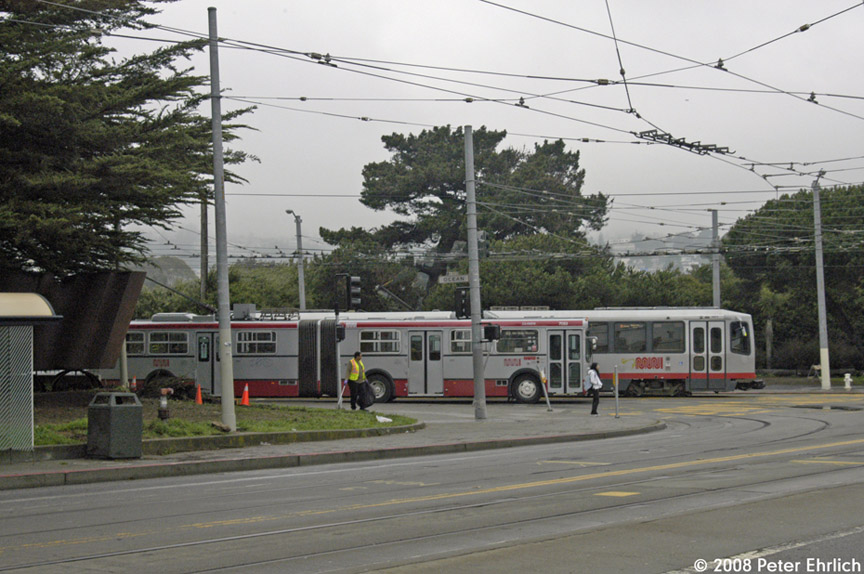 (185k, 864x574)<br><b>Country:</b> United States<br><b>City:</b> San Francisco/Bay Area, CA<br><b>System:</b> SF MUNI<br><b>Line:</b> SF MUNI Trolley Coach Routes<br><b>Location:</b> Ocean/San Jose <br><b>Car:</b> SF MUNI Trolley Coach (Flyer E60, 1992-94)  7053 <br><b>Photo by:</b> Peter Ehrlich<br><b>Date:</b> 1/11/2008<br><b>Notes:</b> Ocean/San Jose inbound.  With Breda 1409.<br><b>Viewed (this week/total):</b> 0 / 1048