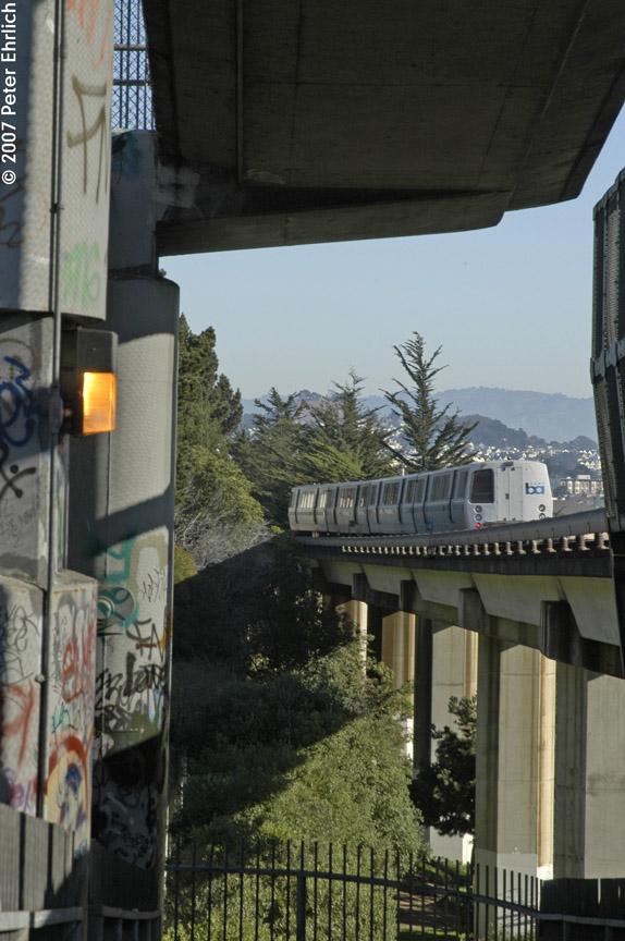 (175k, 574x864)<br><b>Country:</b> United States<br><b>City:</b> San Francisco/Bay Area, CA<br><b>System:</b> BART<br><b>Location:</b> Bet. Balboa Park & Daly City<br><b>Photo by:</b> Peter Ehrlich<br><b>Date:</b> 11/22/2007<br><b>Notes:</b> Inbound train above Cayuga Playground @ Naglee Ave & Alemany Blvd.<br><b>Viewed (this week/total):</b> 1 / 1679