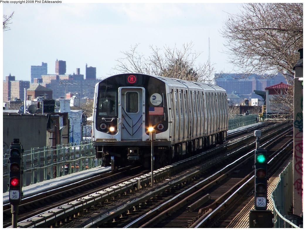 (277k, 1044x788)<br><b>Country:</b> United States<br><b>City:</b> New York<br><b>System:</b> New York City Transit<br><b>Line:</b> BMT Myrtle Avenue Line<br><b>Location:</b> Fresh Pond Road <br><b>Route:</b> M<br><b>Car:</b> R-143 (Kawasaki, 2001-2002) 8261 <br><b>Photo by:</b> Philip D'Allesandro<br><b>Date:</b> 1/20/2008<br><b>Viewed (this week/total):</b> 0 / 3720