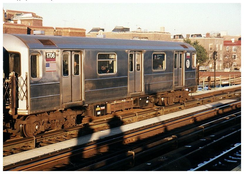 (111k, 830x591)<br><b>Country:</b> United States<br><b>City:</b> New York<br><b>System:</b> New York City Transit<br><b>Line:</b> IRT Flushing Line<br><b>Location:</b> 82nd Street/Jackson Heights <br><b>Route:</b> 7<br><b>Car:</b> R-62A (Bombardier, 1984-1987)  1706 <br><b>Photo by:</b> Gary Chatterton<br><b>Date:</b> 12/7/2002<br><b>Viewed (this week/total):</b> 0 / 3473