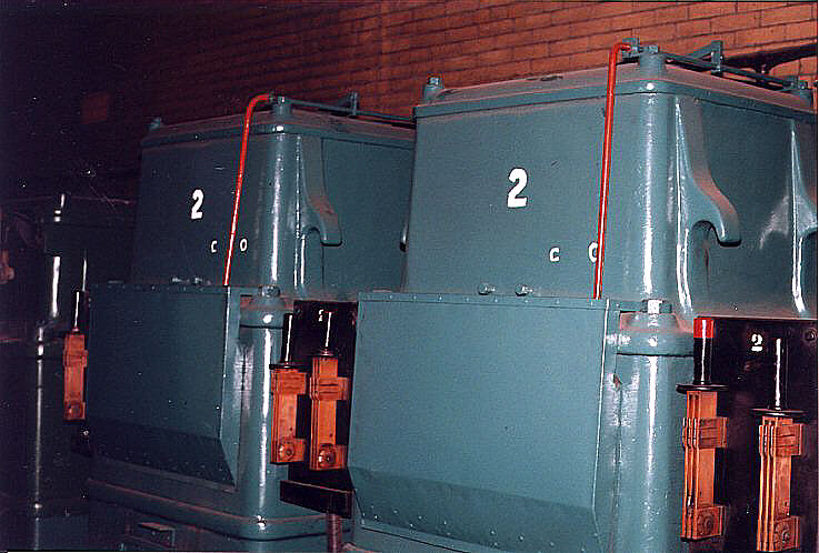 (87k, 737x498)<br><b>Country:</b> United States<br><b>City:</b> New York<br><b>System:</b> New York City Transit<br><b>Location:</b> IRT Substation 21<br><b>Photo by:</b> David M. Rosenthal<br><b>Date:</b> 10/22/1996<br><b>Notes:</b> Transformers feeding power to rotary converter #2. Each transformer is a single phase and steps-down 11000 VAC 25Hz to 390VAC.<br><b>Viewed (this week/total):</b> 4 / 11044