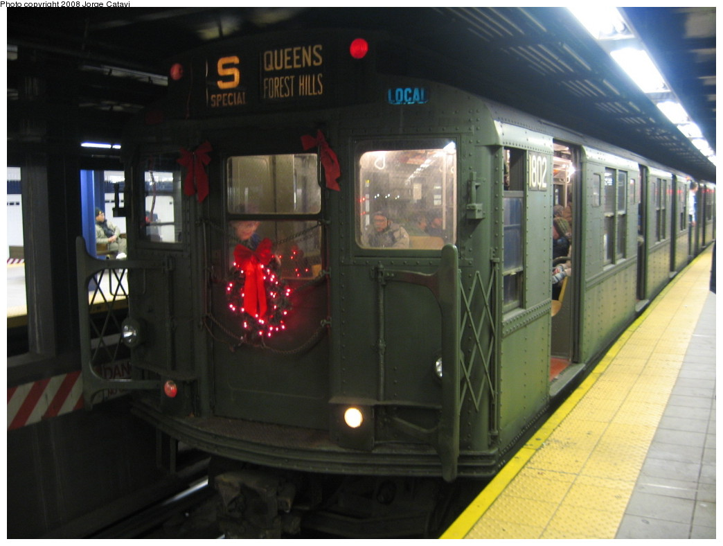 (168k, 1044x788)<br><b>Country:</b> United States<br><b>City:</b> New York<br><b>System:</b> New York City Transit<br><b>Line:</b> IND Queens Boulevard Line<br><b>Location:</b> Queens Plaza <br><b>Route:</b> Museum Train Service (V)<br><b>Car:</b> R-9 (Pressed Steel, 1940)  1802 <br><b>Photo by:</b> Jorge Catayi<br><b>Date:</b> 12/2/2007<br><b>Viewed (this week/total):</b> 0 / 1479