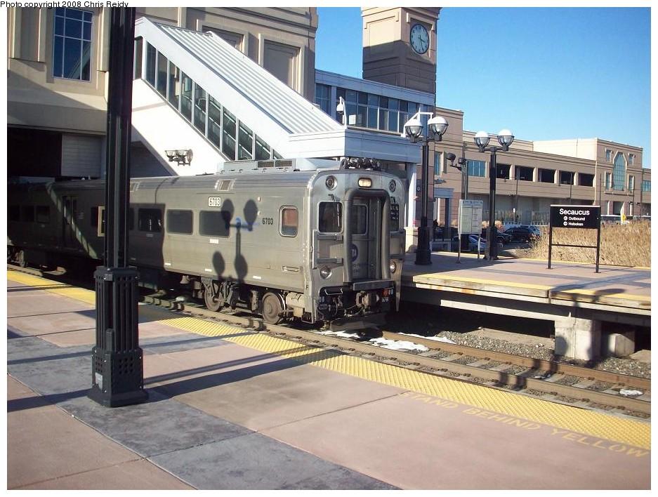 (210k, 937x708)<br><b>Country:</b> United States<br><b>System:</b> NJ Transit (or Predecessor)<br><b>Line:</b> NJT Main/Bergen Line<br><b>Location:</b> Secaucus Junction <br><b>Car:</b> NJT Comet V 6703 <br><b>Photo by:</b> Chris Reidy<br><b>Date:</b> 2/14/2008<br><b>Viewed (this week/total):</b> 3 / 1931