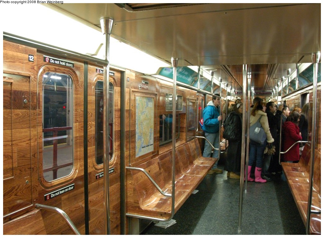 (272k, 1044x765)<br><b>Country:</b> United States<br><b>City:</b> New York<br><b>System:</b> New York City Transit<br><b>Line:</b> IRT Times Square-Grand Central Shuttle<br><b>Location:</b> Times Square <br><b>Route:</b> S<br><b>Car:</b> R-62A (Bombardier, 1984-1987)  1925 <br><b>Photo by:</b> Brian Weinberg<br><b>Date:</b> 2/22/2008<br><b>Notes:</b> Car is wrapped with an advertisement for Swiffer.<br><b>Viewed (this week/total):</b> 2 / 4520