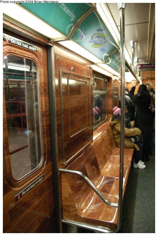 (193k, 551x820)<br><b>Country:</b> United States<br><b>City:</b> New York<br><b>System:</b> New York City Transit<br><b>Line:</b> IRT Times Square-Grand Central Shuttle<br><b>Location:</b> Times Square <br><b>Route:</b> S<br><b>Car:</b> R-62A (Bombardier, 1984-1987)  1925 <br><b>Photo by:</b> Brian Weinberg<br><b>Date:</b> 2/22/2008<br><b>Notes:</b> Car is wrapped with an advertisement for Swiffer.<br><b>Viewed (this week/total):</b> 0 / 2195