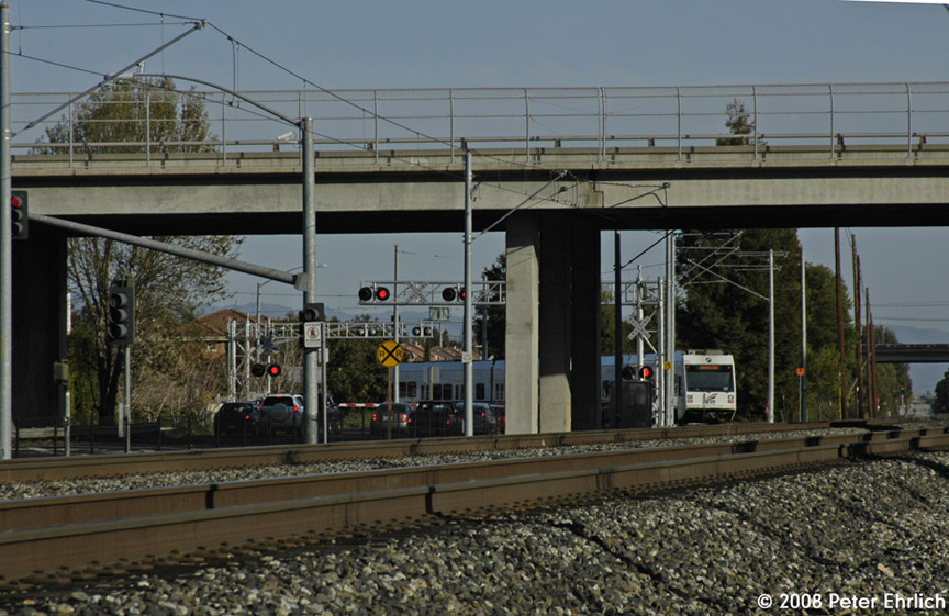 (196k, 864x561)<br><b>Country:</b> United States<br><b>City:</b> San Jose, CA<br><b>System:</b> Santa Clara VTA<br><b>Line:</b> VTA Tasman West/Mountain View<br><b>Location:</b> Evelyn <br><b>Car:</b> VTA Kinki-Sharyo 933 <br><b>Photo by:</b> Peter Ehrlich<br><b>Date:</b> 2/13/2008<br><b>Notes:</b> Approaching/crossing Evelyn Avenue inbound (southbound).<br><b>Viewed (this week/total):</b> 0 / 775