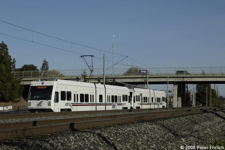 (155k, 864x574)<br><b>Country:</b> United States<br><b>City:</b> San Jose, CA<br><b>System:</b> Santa Clara VTA<br><b>Line:</b> VTA Tasman West/Mountain View<br><b>Location:</b> Evelyn <br><b>Car:</b> VTA Kinki-Sharyo 991 <br><b>Photo by:</b> Peter Ehrlich<br><b>Date:</b> 2/13/2008<br><b>Notes:</b> Approaching/crossing Evelyn Avenue inbound (southbound).<br><b>Viewed (this week/total):</b> 0 / 712