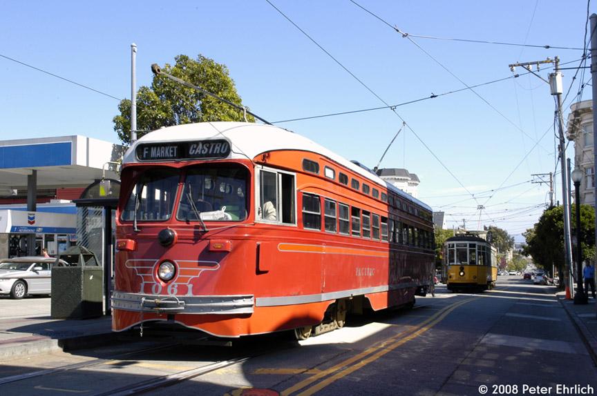 (190k, 864x574)<br><b>Country:</b> United States<br><b>City:</b> San Francisco/Bay Area, CA<br><b>System:</b> SF MUNI<br><b>Location:</b> Market/17th/Castro <br><b>Car:</b> SF MUNI PCC (Ex-SEPTA) (St. Louis Car Co., 1947-1948)  1061 <br><b>Photo by:</b> Peter Ehrlich<br><b>Date:</b> 3/8/2008<br><b>Notes:</b> 17th Street/Castro Terminal.  With 1811 (Milan 1928 yellow/white) behind.<br><b>Viewed (this week/total):</b> 0 / 588