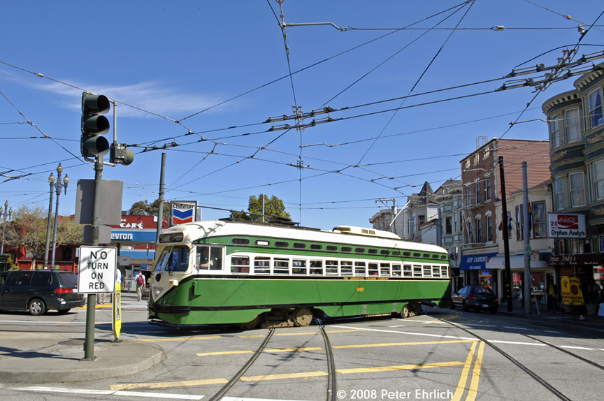 (202k, 864x574)<br><b>Country:</b> United States<br><b>City:</b> San Francisco/Bay Area, CA<br><b>System:</b> SF MUNI<br><b>Location:</b> Market/17th/Castro <br><b>Car:</b> SF MUNI PCC (Ex-SEPTA) (St. Louis Car Co., 1947-1948)  1062 <br><b>Photo by:</b> Peter Ehrlich<br><b>Date:</b> 3/8/2008<br><b>Notes:</b> Leaving 17th Street/Castro Terminal.<br><b>Viewed (this week/total):</b> 0 / 543