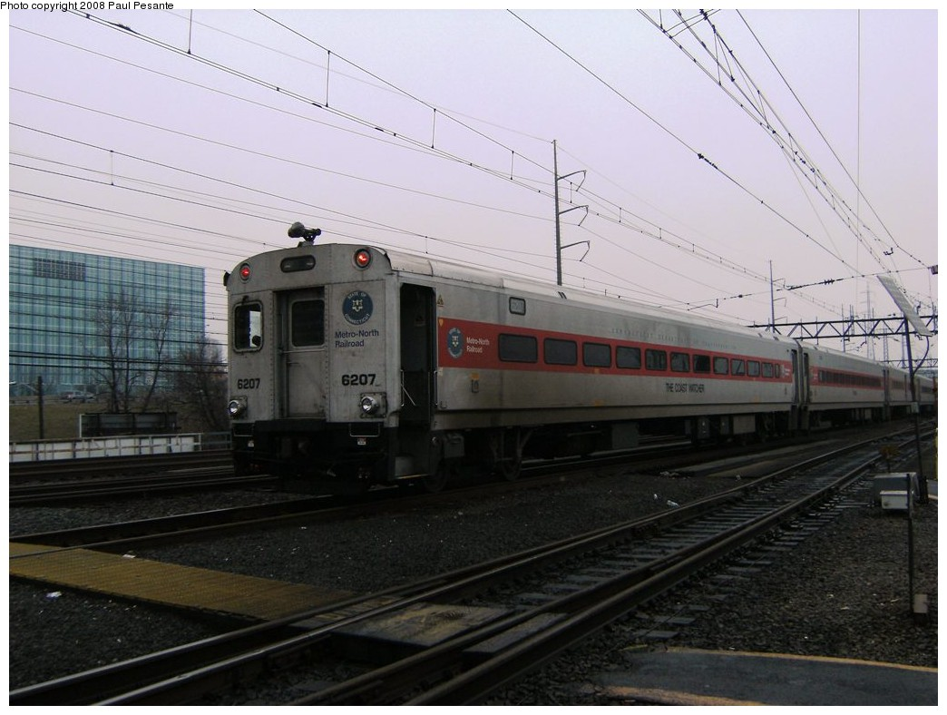 (180k, 1044x788)<br><b>Country:</b> United States<br><b>System:</b> Metro-North Railroad (or Amtrak or Predecessor RR)<br><b>Line:</b> Metro North-New Haven Line<br><b>Location:</b> Stamford <br><b>Car:</b> MNRR/CDOT Shoreliner (Bombardier) 6207 <br><b>Photo by:</b> Paul Pesante<br><b>Date:</b> 3/8/2008<br><b>Notes:</b> Bombardier End Door Cab Car # 6207 laid up on a dreary Saturday morning in Stamford Yard on Loop Track 6. The photographer is a railroad employee on railroad property with permission, and would like to remind everyone to keep railfanning legal and safe- Do not enter restricted areas!<br><b>Viewed (this week/total):</b> 1 / 937