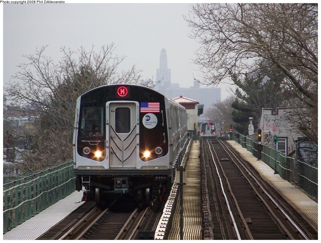 (300k, 1044x788)<br><b>Country:</b> United States<br><b>City:</b> New York<br><b>System:</b> New York City Transit<br><b>Line:</b> BMT Myrtle Avenue Line<br><b>Location:</b> Fresh Pond Road <br><b>Route:</b> M<br><b>Car:</b> R-160A-1 (Alstom, 2005-2008, 4 car sets)  8357 <br><b>Photo by:</b> Philip D'Allesandro<br><b>Date:</b> 4/7/2008<br><b>Notes:</b> First day of full 8-car R160A trains on the M line.<br><b>Viewed (this week/total):</b> 3 / 2335