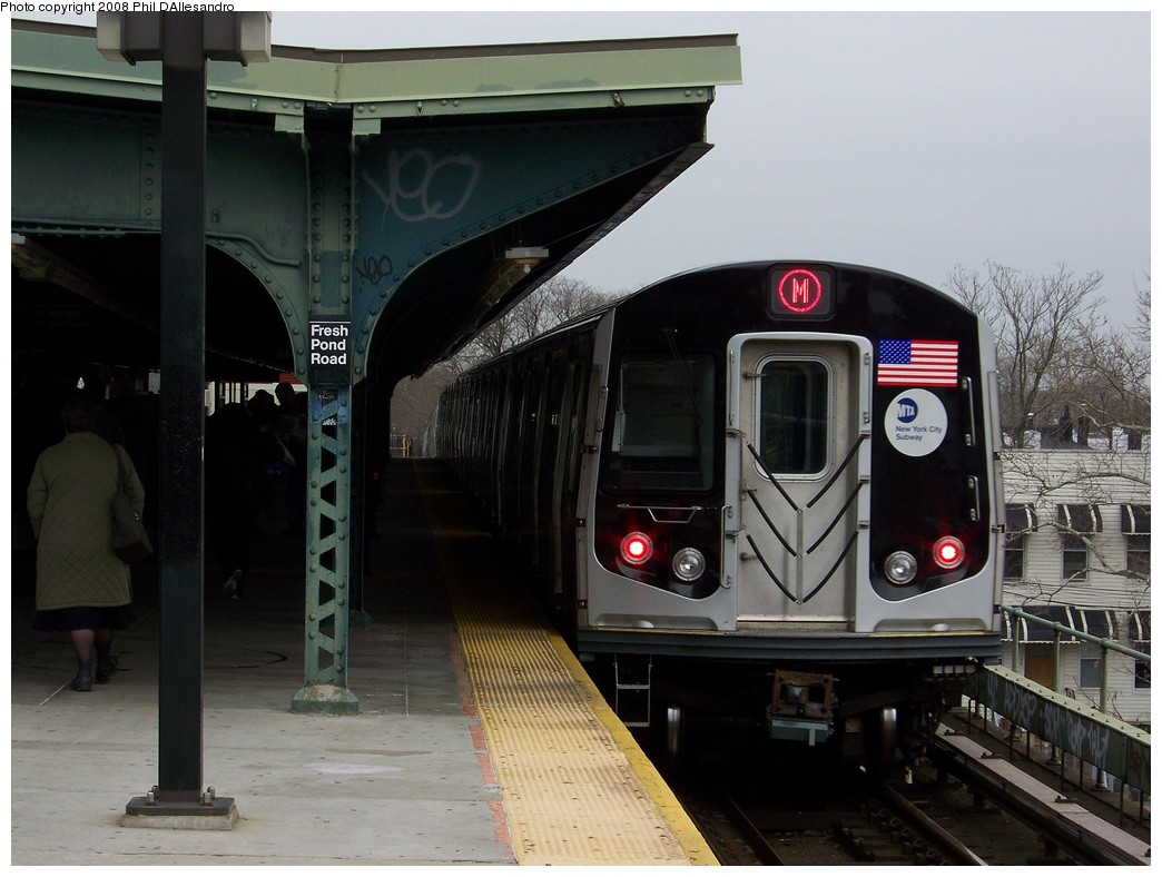 (196k, 1044x788)<br><b>Country:</b> United States<br><b>City:</b> New York<br><b>System:</b> New York City Transit<br><b>Line:</b> BMT Myrtle Avenue Line<br><b>Location:</b> Fresh Pond Road <br><b>Route:</b> M<br><b>Car:</b> R-160A-1 (Alstom, 2005-2008, 4 car sets)  8385 <br><b>Photo by:</b> Philip D'Allesandro<br><b>Date:</b> 4/7/2008<br><b>Notes:</b> First day of full 8-car R160A trains on the M line.<br><b>Viewed (this week/total):</b> 0 / 1752