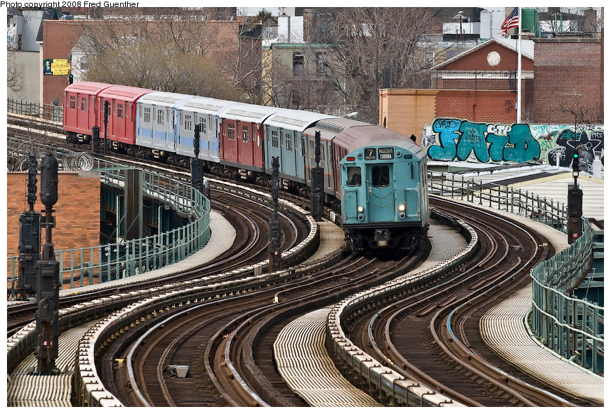 (310k, 870x589)<br><b>Country:</b> United States<br><b>City:</b> New York<br><b>System:</b> New York City Transit<br><b>Line:</b> IRT Flushing Line<br><b>Location:</b> 61st Street/Woodside <br><b>Route:</b> Museum Train Service (7)<br><b>Car:</b> R-33 World's Fair (St. Louis, 1963-64) 9306 <br><b>Photo by:</b> Fred Guenther<br><b>Date:</b> 4/8/2008<br><b>Notes:</b> Coming down the hill to Woodside.<br><b>Viewed (this week/total):</b> 0 / 2052