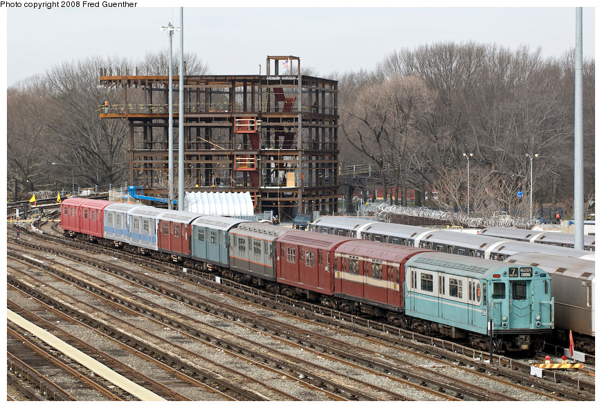 (279k, 870x589)<br><b>Country:</b> United States<br><b>City:</b> New York<br><b>System:</b> New York City Transit<br><b>Location:</b> Corona Yard<br><b>Route:</b> Museum Train Service (7)<br><b>Car:</b> R-33 World's Fair (St. Louis, 1963-64) 9306 <br><b>Photo by:</b> Fred Guenther<br><b>Date:</b> 4/8/2008<br><b>Notes:</b> Museum IRT SMEE train, from right to left: R33 WF 9306; R15 6239, R17 6609, R12 5760, R33 pair 9068 (green) and 9069 (redbird red), R33 pair 9010-9011 (MTA blue/silver), R33 pair 9016-9017 (bright red).<br><b>Viewed (this week/total):</b> 0 / 3250