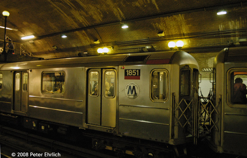 (188k, 864x554)<br><b>Country:</b> United States<br><b>City:</b> New York<br><b>System:</b> New York City Transit<br><b>Line:</b> IRT West Side Line<br><b>Location:</b> 168th Street <br><b>Car:</b> R-62A (Bombardier, 1984-1987)  1851 <br><b>Photo by:</b> Peter Ehrlich<br><b>Date:</b> 5/2/2008<br><b>Notes:</b> Note old logo (MTA logo peeled off).<br><b>Viewed (this week/total):</b> 1 / 2832