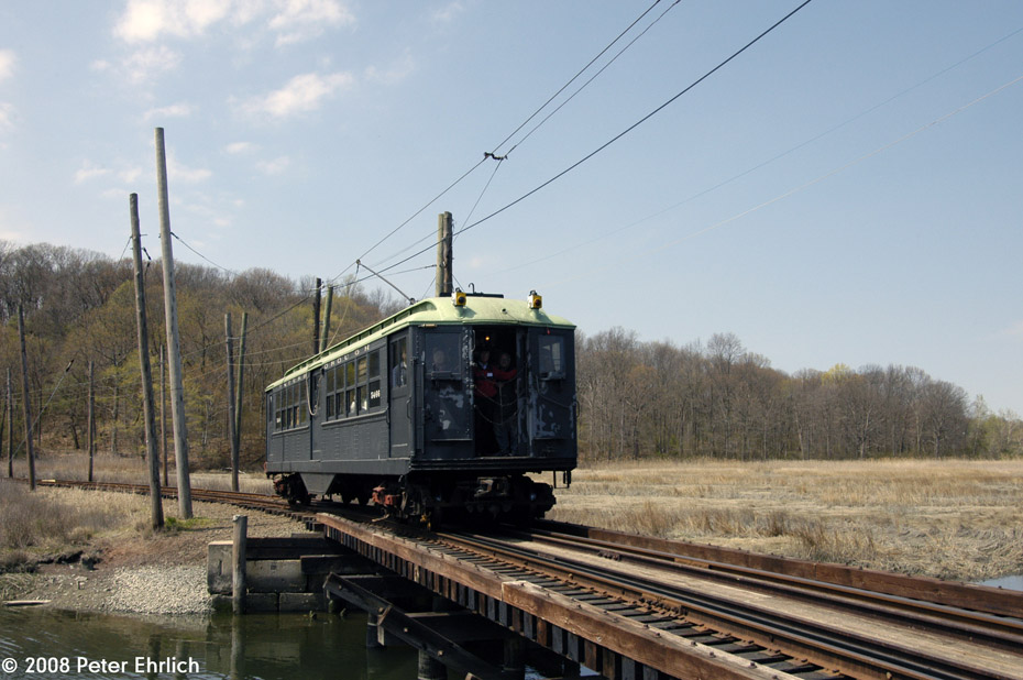 (188k, 930x618)<br><b>Country:</b> United States<br><b>City:</b> East Haven/Branford, Ct.<br><b>System:</b> Shore Line Trolley Museum <br><b>Car:</b> Low-V 5466 <br><b>Photo by:</b> Peter Ehrlich<br><b>Date:</b> 4/26/2008<br><b>Notes:</b> Crossing trestle west of South Beach eastbound.<br><b>Viewed (this week/total):</b> 1 / 961