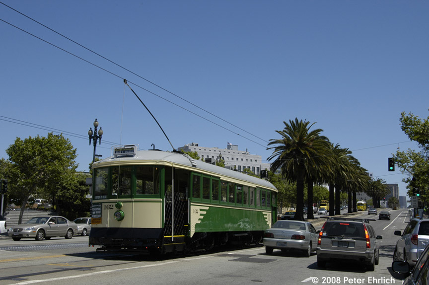 (151k, 864x574)<br><b>Country:</b> United States<br><b>City:</b> San Francisco/Bay Area, CA<br><b>System:</b> SF MUNI<br><b>Location:</b> Market/Church/14th <br><b>Car:</b> SF MUNI B-Type (Jewett Car Co, 1914)  162 <br><b>Photo by:</b> Peter Ehrlich<br><b>Date:</b> 5/17/2008<br><b>Notes:</b> Market/14th Street inbound, trailing view, after turning from Church Street. With PCC 1063 (Baltimore) outbound on the right.<br><b>Viewed (this week/total):</b> 0 / 421