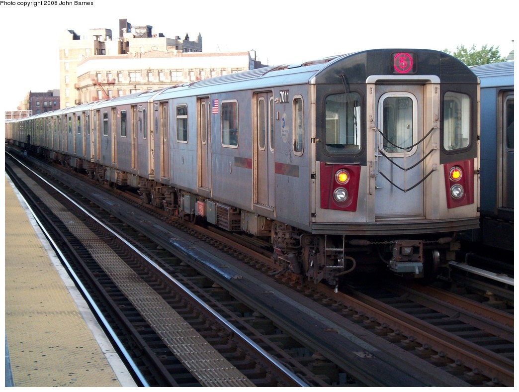 (214k, 1044x788)<br><b>Country:</b> United States<br><b>City:</b> New York<br><b>System:</b> New York City Transit<br><b>Line:</b> IRT White Plains Road Line<br><b>Location:</b> Simpson Street <br><b>Route:</b> 5<br><b>Car:</b> R-142 (Option Order, Bombardier, 2002-2003)  7011 <br><b>Photo by:</b> John Barnes<br><b>Date:</b> 5/19/2008<br><b>Viewed (this week/total):</b> 1 / 3600