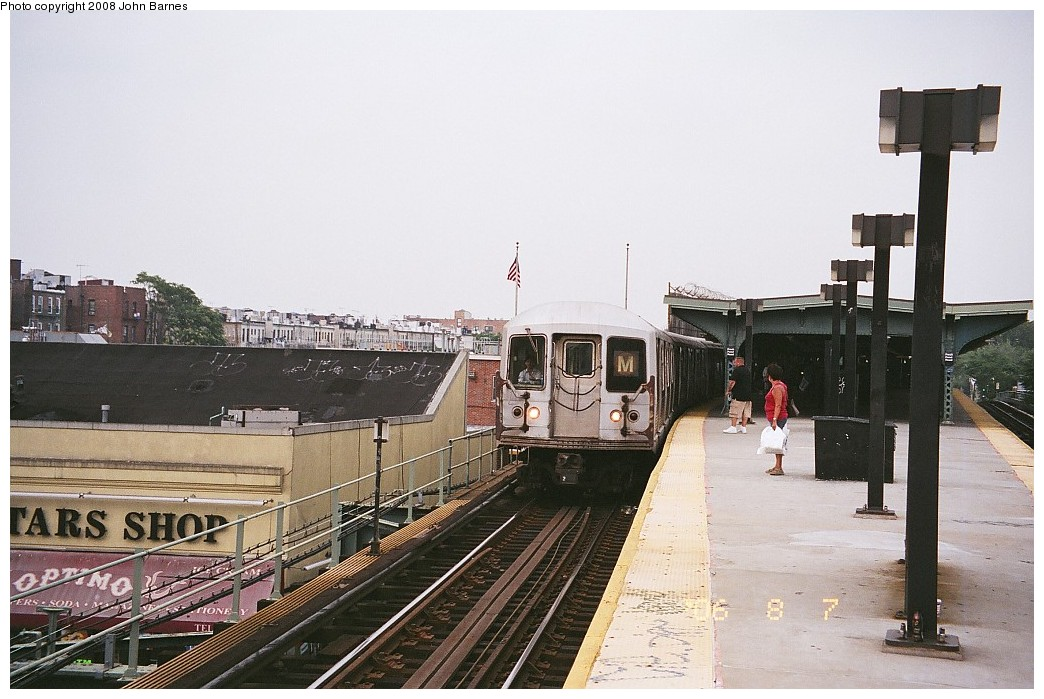 (208k, 1044x699)<br><b>Country:</b> United States<br><b>City:</b> New York<br><b>System:</b> New York City Transit<br><b>Line:</b> BMT Myrtle Avenue Line<br><b>Location:</b> Fresh Pond Road <br><b>Route:</b> M<br><b>Car:</b> R-42 (St. Louis, 1969-1970)   <br><b>Photo by:</b> John Barnes<br><b>Date:</b> 8/6/2006<br><b>Viewed (this week/total):</b> 0 / 1632